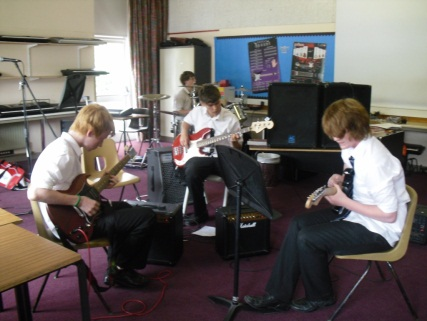 Picture of students playing music